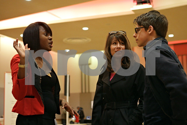 Rob Winner – rwinner@shawmedia.com<br /> <br /> Northern Illinois University representative Jonitiana Kelly (left) speaks with Dana Ingle and her stepson Grayson Ingle (right), 17, of Springfield, about housing arrangements during an open house visit at NIU in DeKalb, Ill., on Friday, March 29, 2013.