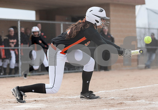 Erik Anderson - For the Daily Chronicle <br /> DeKalb's Hannah Walter makes the bunt and steals first base during early gameplay action at DeKalb High School in DeKalb on Friday, April 5, 2013.