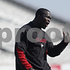 Rob Winner – rwinner@shawmedia.com<br /> <br /> Northern Illinois defensive graduate assistant Olaitan Oguntodu instructs the team during practice at Huskie Stadium in DeKalb, Ill., Friday, March 29, 2013.