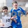 Erik Anderson - For the Daily Chronicle <br /> The Hawks Yulissa Solis (10) and Lady Royals Anne Klein battle for possession of the ball by the sideline during the first half of the match up at Hiawatha High School in Kirkland on Wednesday, April 3, 2013.