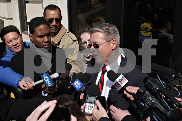 Rob Winner – rwinner@shawmedia.com<br /> <br /> Public defender  Tom McCulloch speaks to members of the media outside the DeKalb County Courthouse in Sycamore following the plea agreement of William Curl on Wednesday, April 3, 2013.