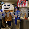 Erik Anderson - For the Daily Chronicle <br /> Scoopie, the Culver's mascot is directed out from the kitchen by a volunteer during the Matthew Ranken benefit at Culver's in Sycamore on Tuesday, April 2, 2013.  Scoopie made it's way outside with volunteer Edwina Elder during the night collecting donations from on-lookers and people in their vehicles as well.