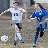 Erik Anderson - For the Daily Chronicle <br /> Hiawatha forward Yulissa Solis (10) and Hinckley-Big Rock defender Emily Banigan race toward the ball in the midfield during the match up at Hiawatha High School in Kirkland on Wednesday, April 3, 2013.