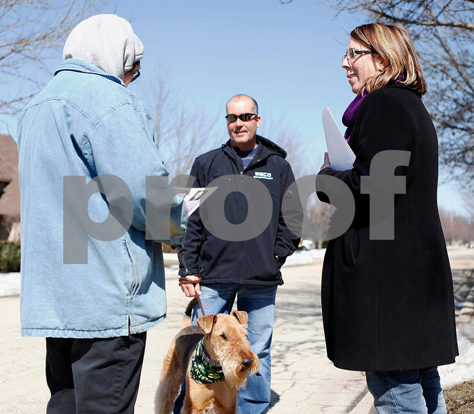Erik Anderson - For the Daily Chronicle<br /> Mayoral candidate Jennifer Groce talks to passers-by Jeff Weber and his wife Debbie as they walk their dog Lacie down the street of the Fairway Oaks subdivision in DeKalb on Saturday, March 23, 2013.