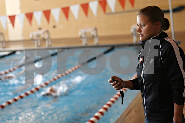Chronicle File Photo<br /> Coach Leah Eames times her swimmers during practice at the DeKalb High School swimming pool in DeKalb, ill., on Wednesday Sept. 2, 2009.