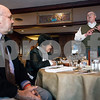 Erik Anderson - For the Daily Chronicle <br /> Jerry Smith (right) speaks to the attendees during the fundraiser event as mayoral candidate John Rey sits (far left) at the Hillside Restaurant in downtown DeKalb on Thursday, March 28, 2013.
