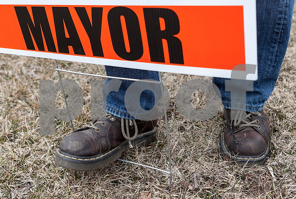 """Erik Anderson - For the Daily Chronicle <br /> Mayoral candidate Mike Verbic steps on a """"Verbic for Mayor"""" sign in front on Nick Velasquez's house on Taylor Street on Saturday, March 30, 2013."""