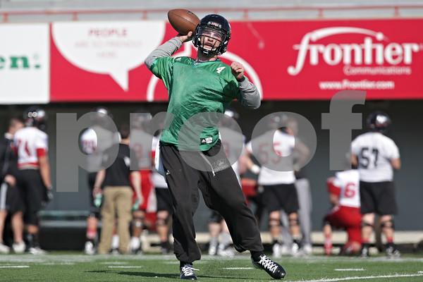 Rob Winner – rwinner@shawmedia.com<br /> <br /> Northern Illinois quarterback Jordan Lynch passes the ball during practice at Huskie Stadium in DeKalb, Ill., Friday, March 29, 2013.