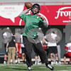 Rob Winner – rwinner@shawmedia.com<br /> <br /> Northern Illinois quarterback Jordan Lynch passes the ball during practice at Huskie Stadium in DeKalb, Ill., Friday, March 29, 2013.