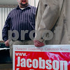 Erik Anderson - For the Daily Chronicle <br /> Paul Meier of DeKalb holds a yard sign while speaking to mayoral candidate David Jacobson during a fundraiser event held at the Best Western DeKalb Inn & Suites on Friday, March 29, 2013.