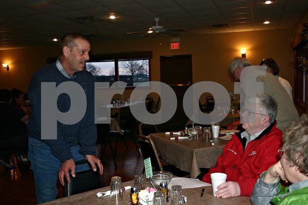 Indian Creek School District 425 board candidate Paul Delisio talks with district resident Jim Allen Wednesday at a public meet and greet with the candidates at the Indian Oaks Country Club in Shabbona.  (Stephanie Hickman - shickman@shawmedia.com)