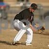 Rob Winner – rwinner@shawmedia.com<br /> <br /> DeKalb first baseman Corey Nelson fields a bunted ball in the top of the third inning during a game against West Aurora in DeKalb, Ill., Tuesday, April 2, 2013. West Aurora defeated DeKalb, 4-1.