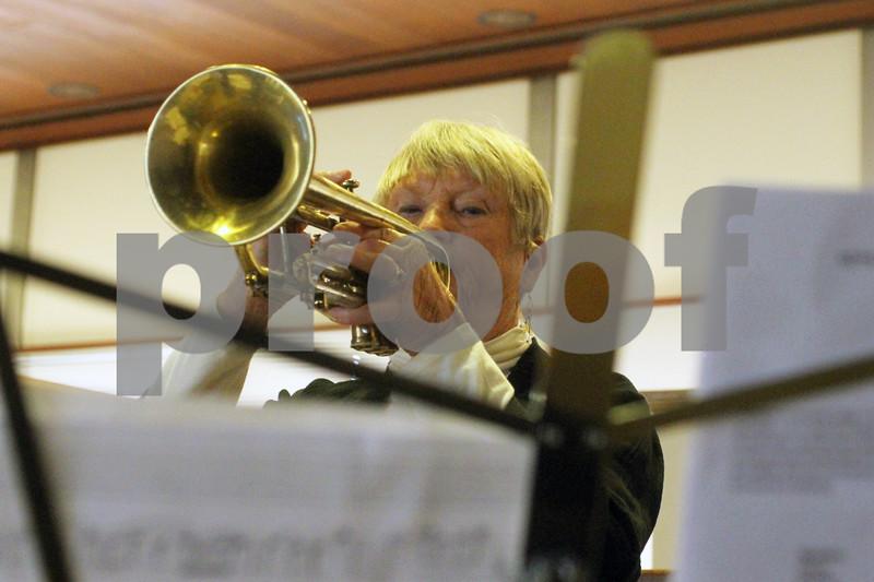 DeKalb resident Judy Sisler plays her instrument during Easter Worship at the Bethlehem Evangelical Lutheran Church on Sunday.