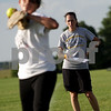 Chronicle File Photo<br /> <br /> Coach Jill Carpenter (right) watches during tryouts for a new 14U travel fastpitch softball team for called Sycamore Flash, at the Sycamore High School softball field in Sycamore, Ill., on Wednesday July 28, 2010.