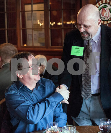 Erik Anderson - For the Daily Chronicle <br /> Mayoral candidate John Rey (right) talks with fundraiser attendee Jon Hadley before the main entree at the Hillside Restaurant in downtown DeKalb on Thursday, March 28, 2013.