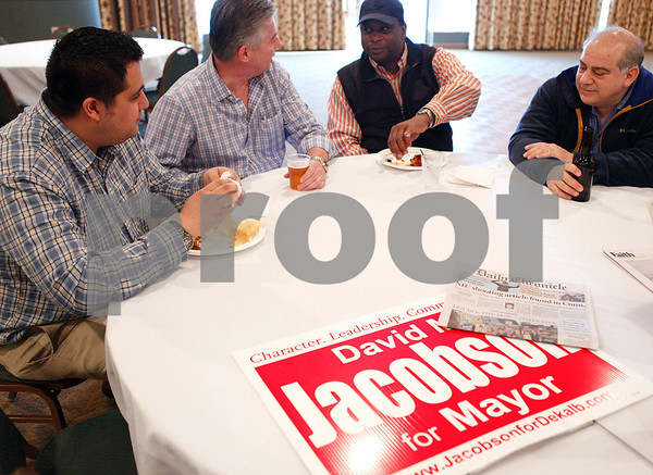 Erik Anderson - For the Daily Chronicle <br /> Attendees of mayoral candidate David Jacobson's fundraiser eat food and discuss topics with each other at the Best Western DeKalb Inn & Suites on Friday, March 29, 2013.
