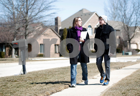 Erik Anderson - For the Daily Chronicle<br /> Mayoral candidate Jennifer Groce  and son, Alex, 14, walk together after dropping off flyers at the first few houses in the Fairway Oaks subdivision in DeKalb on Saturday, March 23, 2013.