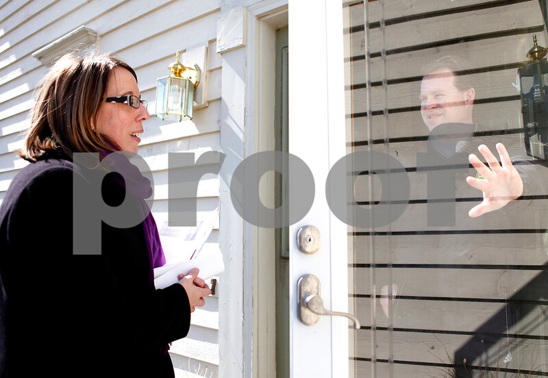 Erik Anderson - For the Daily Chronicle<br /> Mayoral candidate Jennifer Groce speaks to resident Scott Newport at his home while handing out flyers with her family to promote herself in the Mayoral race at the Fairway Oaks subdivision in DeKalb on Saturday, March 23, 2013.