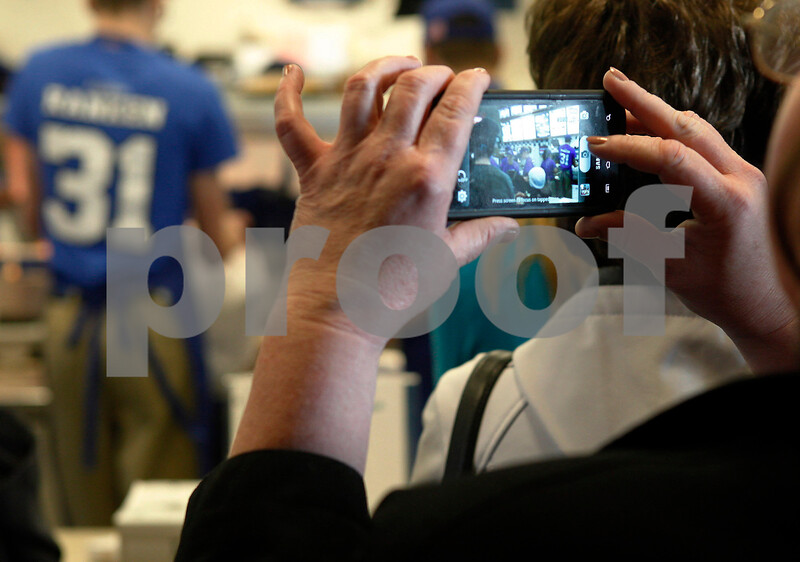 Erik Anderson - For the Daily Chronicle <br /> Connie Jacober of Genoa takes a picture on her cell phone of the chaos in the kitchen as employees cater to the ongoing rush of people during the Matthew Ranken benefit at Culver's in Sycamore on Tuesday, April 2, 2013.