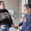 Erik Anderson - For the Daily Chronicle <br /> Mayoral candidate Mike Verbic discusses topics about his campaign with Taylor Street resident Nick Velasquez of DeKalb on Saturday, March 30, 2013.