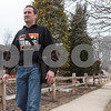 Erik Anderson - For the Daily Chronicle <br /> Mayoral candidate Mike Verbic carries a messenger bag of fliers while walking down a sidewalk on Taylor Street while campaigning door to door on Saturday, March 30, 2013.