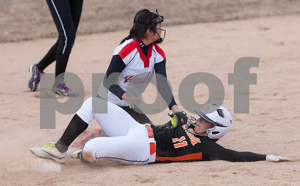 Erik Anderson - For the Daily Chronicle <br /> Hinsdale's Emily Park nearly tags DeKalb's Sabrina Killeen who stole second during the match up at DeKalb High School in DeKalb on Friday, April 5, 2013.