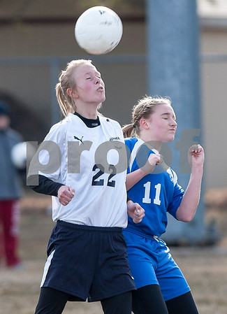 Erik Anderson - For the Daily Chronicle <br /> The Hawks Ida Bentzon (22) challenges the Lady Royals Andrea Binkley for possession of the ball during the first half of the match up at Hiawatha High School in Kirkland on Wednesday, April 3, 2013.