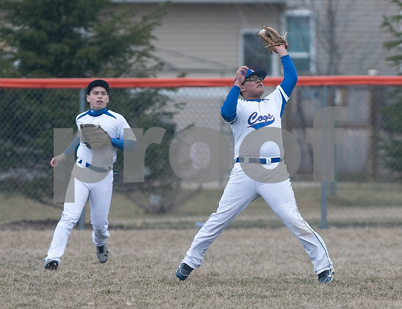 Erik Anderson - For the Daily Chronicle <br /> Genoa-Kingston's Max Hernandez (right) catches the ball for an out during mid gameplay action as Genoa-Kingston and Burlington Central competed at Genoa-Kingston High School on Tuesday, April 9, 2013. Burlington Central defeated Genoa-Kingston 7-2.