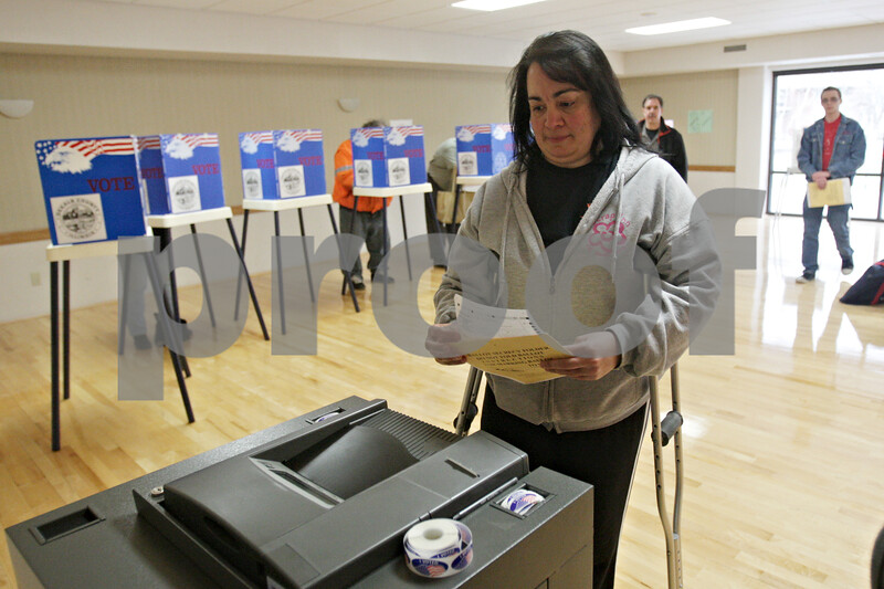 """Rob Winner – rwinner@shawmedia.com<br /> <br /> DeKalb resident Jody Harding prepares to cast her ballot at the Hopkins Park Terrace Room in DeKalb, Ill., Tuesday, April 9, 2013. """"I always think it's important to get out and vote no matter what,"""" said Harding who was on crutches."""
