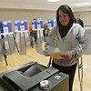 "Rob Winner – rwinner@shawmedia.com<br /> <br /> DeKalb resident Jody Harding prepares to cast her ballot at the Hopkins Park Terrace Room in DeKalb, Ill., Tuesday, April 9, 2013. ""I always think it's important to get out and vote no matter what,"" said Harding who was on crutches."