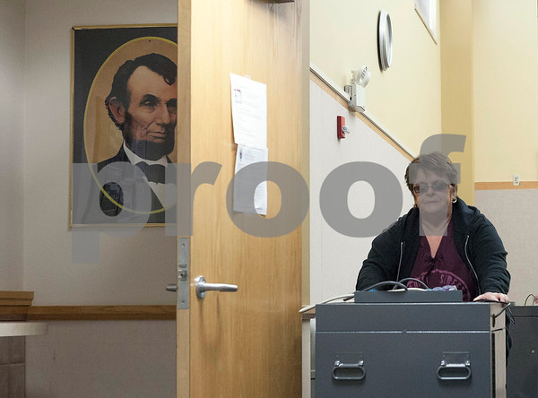 Erik Anderson for Shaw Media<br /> <br /> Election Judge Rene Donnelly transfers a voting machine to the DeKalb County Legislative Building from the Administration Building for the April 9th Elections while in Sycamore on Saturday, April 6, 2013.