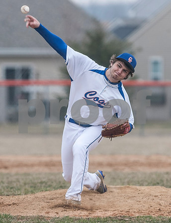 Erik Anderson - For the Daily Chronicle <br /> The Cogs Adam Price pitches to Burlington Central batters in the second inning during the match up of Genoa-Kingston and Burlington Central at Genoa-Kingston High School on Tuesday, April 9, 2013. Burlington Central defeated Genoa-Kingston 7-2.