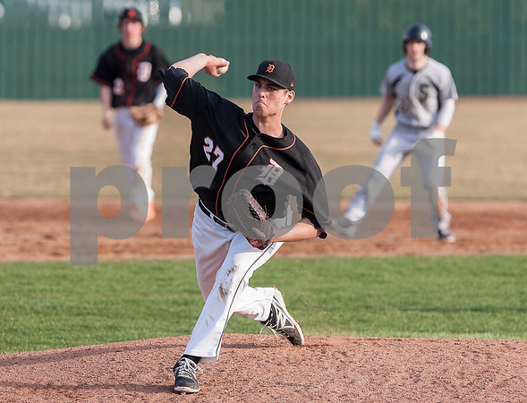 Erik Anderson - For the Daily Chronicle <br /> DeKalb's John Crosby pitches to Sycamore batters during mid gameplay action as Sycamore and DeKalb battle at NIU's Ralph McKinzie Field on Monday, April 8, 2013.