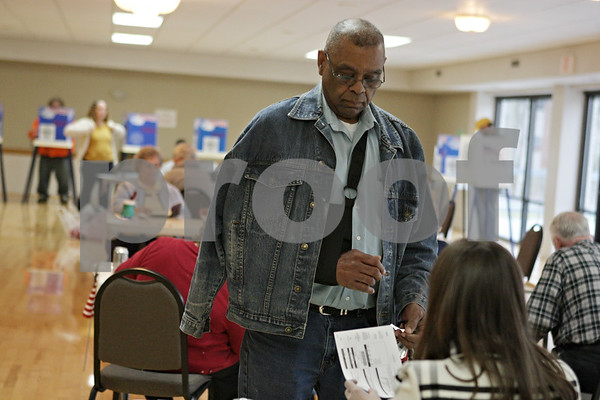 Rob Winner – rwinner@shawmedia.com<br /> <br /> DeKalb resident Kevin Caldwell checks in before receiving his ballot at the Hopkins Park Terrace Room in DeKalb, Ill., Tuesday, April 9, 2013.