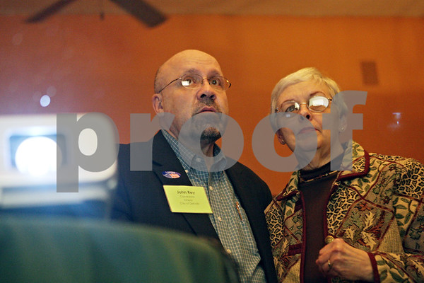 Rob Winner – rwinner@shawmedia.com<br /> <br /> John Rey and his wife Marjorie watch as the election results come in at Eduardo's Mexican Restaurant in DeKalb, Ill., Tuesday, April 9, 2013.