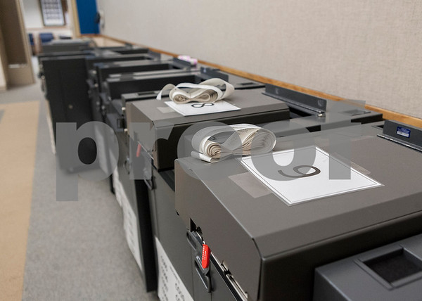 Erik Anderson for Shaw Media<br />  <br /> Voting machines sit waiting to be moved for the April 9th elections at the DeKalb County Administration and Legislative Buildings in Sycamore on Saturday, April 6, 2013.