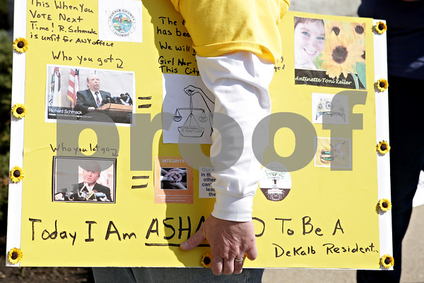 Rob Winner – rwinner@shawmedia.com<br /> <br /> DeKalb resident Darla Cook holds up a sign she made while at a gathering that was held in response to last week's plea agreement of William Curl outside the DeKalb County Courthouse in Sycamore, Ill., Monday, April 8, 2013.