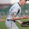Erik Anderson - For the Daily Chronicle <br /> Sycamore's Cooper Vinz tosses the ball and sighs after missing an out at first base during the match up of Sycamore and DeKalb at NIU's Ralph McKinzie Field on Monday, April 8, 2013.