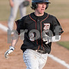 Erik Anderson - For the Daily Chronicle <br /> DeKalb's Jared Johnson runs down the third base line to score during the match up of Sycamore and DeKalb held at NIU's Ralph McKinzie Field on Monday, April 8, 2013.