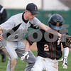 Erik Anderson - For the Daily Chronicle <br /> Sycamore's Cooper Vinz (8) reaches for the ball, but misses the tag as DeKalb's Jared Johnson slides back to first base during the match up of Sycamore and DeKalb at NIU's Ralph McKinzie Field on Monday, April 8, 2013.