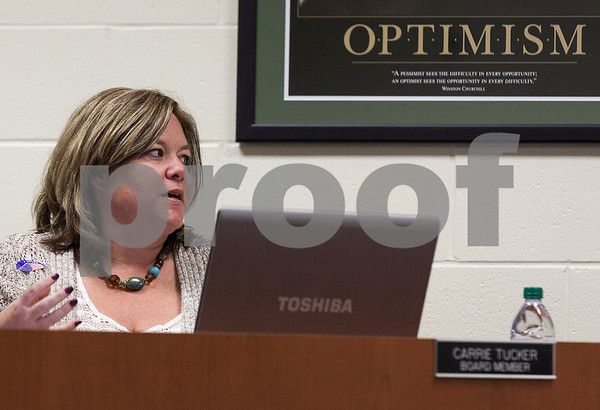 Erik Anderson - For the Daily Chronicle <br /> School board member Carrie Tucker speaks her concern to other members about the 2013-2014 lunch fees during the school board meeting at Genoa-Kingston High School on Tuesday, April 9, 2013.