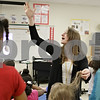 Rob Winner – rwinner@shawmedia.com<br /> <br /> Music teacher Kristine Mutchler instructs a kindergarten class while helping a child with a rubber band caught in her hair during a music lesson at Gwendolyn Brooks Elementary School in DeKalb, Ill., Thursday, April 11, 2013.