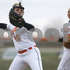 Erik Anderson - For the Daily Chronicle <br /> DeKalb's Tayler Garland (left) picks up a grounder and throws to first base during mid game play action as DeKalb hosted Sycamore at the Huntley Middle School park softball field on Thursday, April 11, 2013. The Barbs defeated the Spartans 3-1 making the Barbs a perfect 10-0.