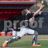 Erik Anderson - For the Daily Chronicle <br /> DeKalb catcher Patrick Aves reaches for the ball but drops it during mid game play action of the Sycamore and DeKalb game held at NIU's Ralph McKinzie Field on Monday, April 8, 2013.
