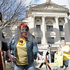 Rob Winner – rwinner@shawmedia.com<br /> <br /> Korrine Huber (left), of South Elgin, plays the guitar as Annie Barson, of Maple Park, holds her music sheets as supporters of Toni Keller's family organized a gathering in response to last week's plea agreement of William Curl outside the DeKalb County Courthouse in Sycamore, Ill., Monday, April 8, 2013.