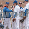 Erik Anderson - For the Daily Chronicle <br /> The Cogs head coach Anson Ellis speaks to his players at the pitchers mound during the match up of Genoa-Kingston and Burlington Central at Genoa-Kingston High School on Tuesday, April 9, 2013. Burlington Central defeated Genoa-Kingston 7-2.