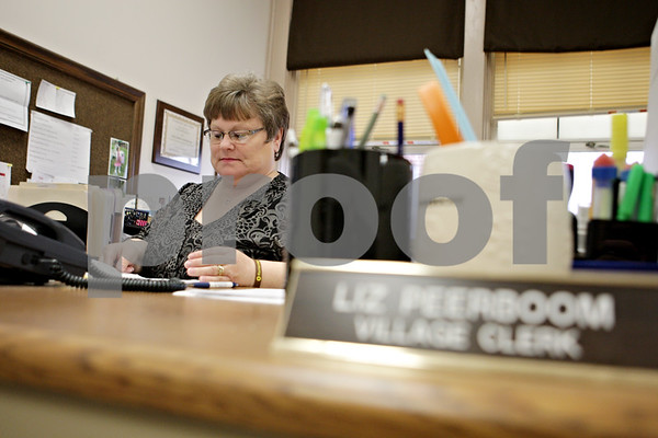 Rob Winner – rwinner@shawmedia.com<br /> <br /> Liz Peerboom works at her desk within the Maple Park Civic Center on Thursday, April 11, 2013. Peerboom who is the village clerk for Maple Park was also recently elected as the next DeKalb city clerk.