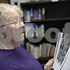 Rob Winner – rwinner@shawmedia.com<br /> <br /> Edie Wisdom, of Sycamore, looks over some historical information while listening to Angelo Nicolosi (not pictured) speak about her father, Frederick Carlson, who served in World War I at  Hillcrest Covenant Church in DeKalb, Ill., Tuesday, April 2, 2013. Carlson passed away in 1987 and Nicolosi had interviewed him about his time served during the war using a tape recorder in 1971.