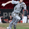 Erik Anderson - For the Daily Chronicle <br /> Sycamore's Davey Scholz sprints down the first base line after a bunt during early gameplay action of the Sycamore and DeKalb game held at NIU's Ralph McKinzie Field on Monday, April 8, 2013.