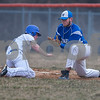 Erik Anderson - For the Daily Chronicle <br /> The Cogs Ben Rabe (left) slides back to first base as the Rockets first baseman Robby Frederickson misses the out during the match up of Genoa-Kingston and Burlington Central at Genoa-Kingston High School on Tuesday, April 9, 2013. Burlington Central defeated Genoa-Kingston 7-2.